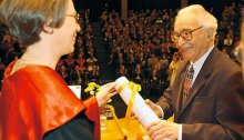 Receiving an Honorary degree in Sacred Theology from Fribourg University, Switzerland, 2004.
